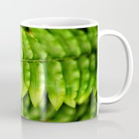 lime green Mugs featuring Lime Green Leaves II by Amelia Kay Photography