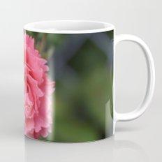 pink wild rose flower in green background. Floral photography. Mug