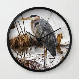 Heron pose along the bank Wall Clock