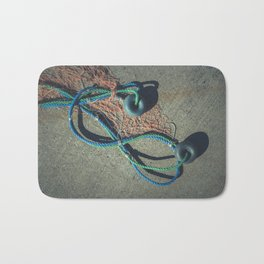 Fishnet with two buoys on rope. Nautical marine concept. Bath Mat