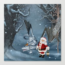 Santa Claus with ice dragon in a winter landscape Canvas Print