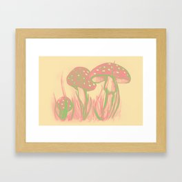 Watercolor of mushrooms in the grass Framed Art Print