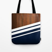navy Tote Bags featuring Wooden Navy by Nicklas Gustafsson