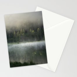 Magic Misty Lake. Amazing shot of a wooden house in the Ferchensee lake in Bavaria, Germany, in front of a mountain belonging to the Alps. Scenic foggy morning scenery at sunrise. Stationery Cards