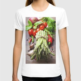 Fresh green asparagus bunch and vegetables on wooden board T-shirt