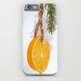 Cold frosty Orange Slice hanging in a tree for the holidays iPhone Case