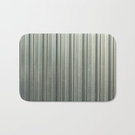 Corrugated iron of aluminum on a facade. Background image. Bath Mat