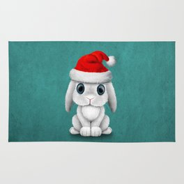 White Floppy Eared Baby Bunny Wearing a Santa Hat Rug