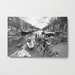 Bicycles and scooter parked next to Amsterdam canal Metal Print