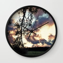 Kissing the ground Wall Clock