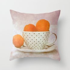 a cup full of apricots Throw Pillow