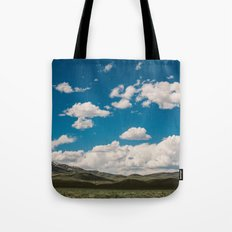 Puffy White Clouds with Blue Sky and Green Meadow Hills Tote Bag
