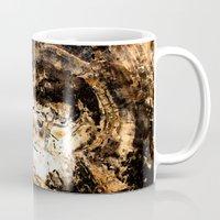tree rings Mugs featuring Petrified Tree Rings II by Mister Groom