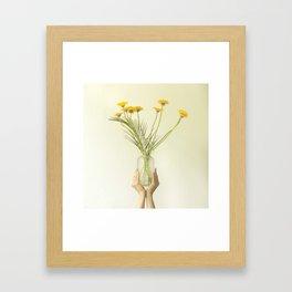 Holding flowers Framed Art Print