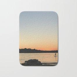 Paddleboarder at sunset Bath Mat