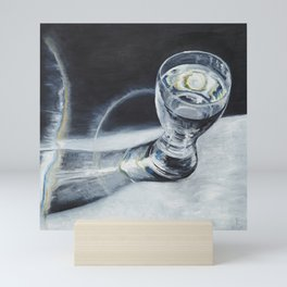 Glass of the water in the light Mini Art Print