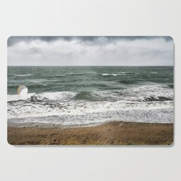 Land and sea under stormy clouds Cutting Board