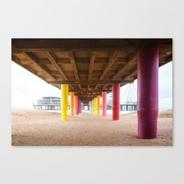Pier with color painted columns on the beach Canvas Print