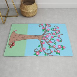 Magical tree with pretty pink flowers Rug