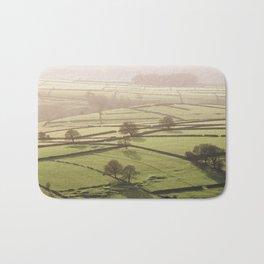 Hazy light at sunset over a valley of fields. Derbyshire, UK. Bath Mat
