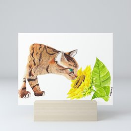 a cat with a sunflower Mini Art Print