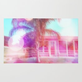 palm tree in the city with colorful bokeh light abstract Rug