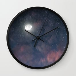 Glowing Moon on the night sky through pink clouds Wall Clock