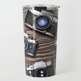 Collection of retro photo cameras on  wood Travel Mug