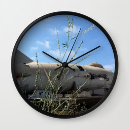 Chuck's MiG sits in a quiet scrapyard. Wall Clock