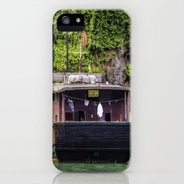 Traditional House Boat with a Clothesline on the back Parked in front of One of Limestone Mountains in Halong Bay, Vietnam iPhone Case