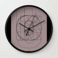 danny haas Wall Clocks featuring Die Neue Haas Grotesk (D) by Bouké