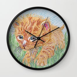 Kitten in grass Wall Clock