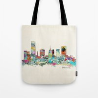 oklahoma Tote Bags featuring Oklahoma City Oklahoma skyline by bri.buckley