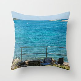 Rocky beach, two chairs and bue sea in Istria, Croatian coast Throw Pillow