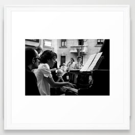 Piano player in the street Framed Art Print