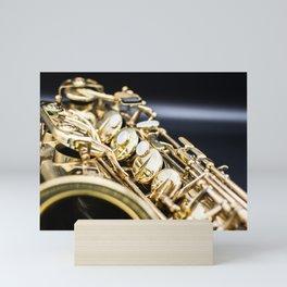 Alto saxophone black background Mini Art Print