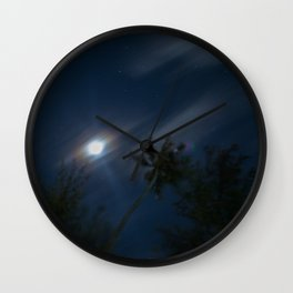 little paradise at night Wall Clock