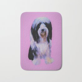 Bearded collie on pink Bath Mat