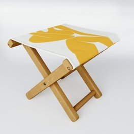 Nude sitting pose in yellow Folding Stool