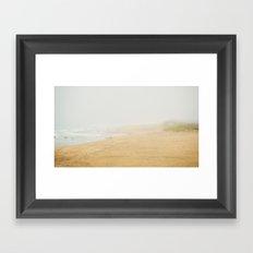 Misty beach Framed Art Print