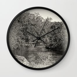Black and white study of a tranquil river Wall Clock