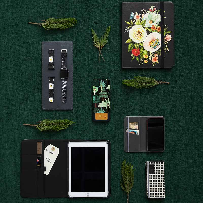 flatlay with different kinds of phone cases, ipad folio cases and more