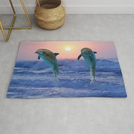 Dolphins at sunrise Rug