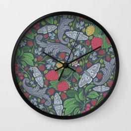Red berries with butterflies and bluebells on dark background Wall Clock