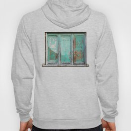 Window with turquoise blinds Hoody