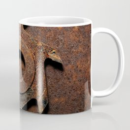Old milling cutter on rusty metal background Coffee Mug