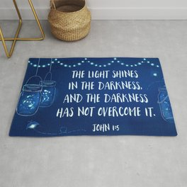 The light shines in the darkness and the darkness has not overcome it. Rug