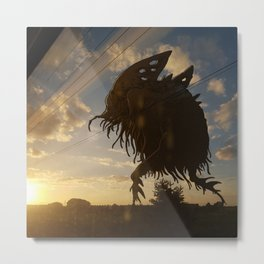 Monstre dans le soleil couchant Metal Print