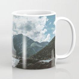 Mountains under cloudy sky Coffee Mug