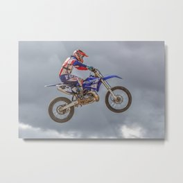 Action motocross biker in blue and red Metal Print